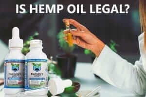 woman holding test tube is cbd hemp oil legal preview